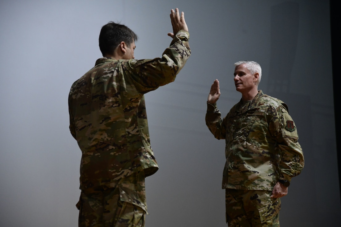 Brig. Gen. Mark A. Maldonado, Deputy Commanding General, Air for the District of Columbia Air National Guard, promotes Col. Keith MacDonald, 113th Wing Commander to the rank of brigadier general the Joint Base Andrews Base Theater, June 9, 2019. (U.S. Air National Guard photo by Staff Sgt. Anthony Small)