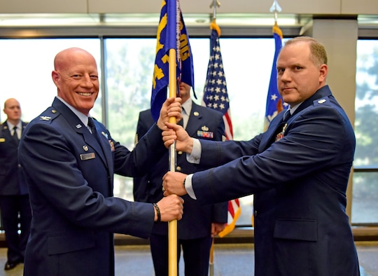 SCHRIEVER AIR FORCE BASE, Colo. – Col. Todd Tobergte, 926th Operations Group commander, presided over the 14th Test Squadron's change of command ceremony June 1, 2019. Outgoing commander, Lt. Col. Adam Fisher, said his farewells as Lt. Col. Glenn Richard took command of the test squadron. (U.S. Air Force photo/Staff Sgt. Laura Turner)