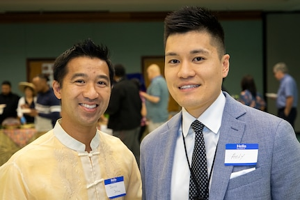 Derrick Delima, Defense Finance and Accounting Service Accounts Maintenance and Control executive assistant, left, and Andy Huynh, U.S. Army Financial Management Command System Support Operations organizational management chief, pose for a photo during an Asian American Pacific Heritage event at the Maj. Gen. Emmett J. Bean Center here June 4, 2019. USAFMCOM and DFAS teamed up to host the event meant to showcase Asian and Pacific Islander heritage, whit this year's event focused specifically on South Korea and the Philippines. (U.S. Army photo by Mark R. W. Orders-Woempner)