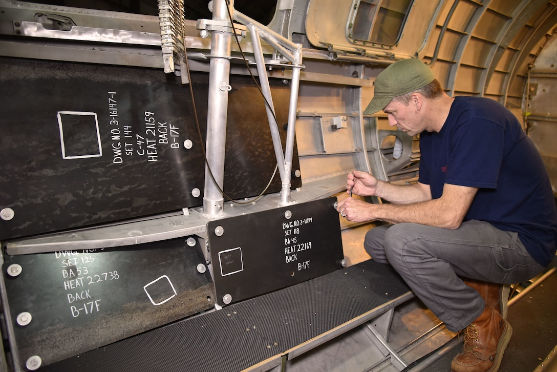 DAYTON, Ohio -- Museum restoration specialist Chad Vanhook works on the waist gun section of the Boeing B-17F Memphis Belle at the National Museum of the U.S. Air Force on June 3, 2019. (U.S. Air Force photo by Ken LaRock)