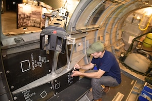 DAYTON, Ohio -- Museum restoration specialist Chad Vanhook views the armor plating of the left waist gun position on the Boeing B-17F Memphis Belle at the National Museum of the U.S. Air Force on June 3, 2019. (U.S. Air Force photo by Ken LaRock)