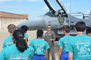 A pilot from the Oklahoma Air National Guard's 138th Fighter Wing briefs students on the capabilities of the F-16 Fighting Falcon. The 2019 Aviation Career Education, or ACE academy provides middle and high school kids weeklong immersion experiences in a variety of aviation and aerospace professions. The Oklahoma City ACE toured with the 507th ARW on June 5, 2019 at Tinker Air Force Base, Oklahoma. (U.S. Air Force Photo by Maj. Jon Quinlan)