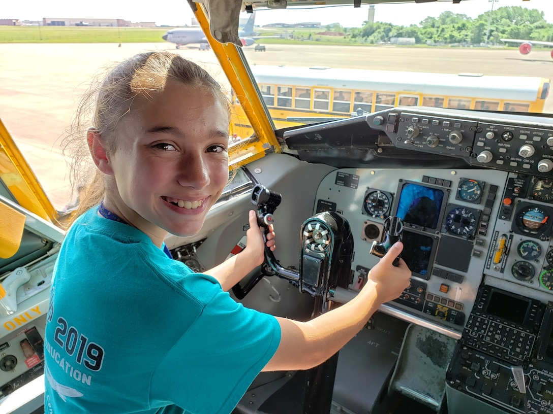 A student and participant in the 2019 Aviation Career Education Academy poses in the aircraft commander's seat in an Air Force Reserve KC-135R Stratotanker. The ACE academy provides middle school students weeklong immersion experiences in a variety of aviation and aerospace professions. The Oklahoma City ACE toured with the 507th ARW on June 5, 2019 at Tinker Air Force Base, Oklahoma. (U.S. Air Force Photo by Maj. Jon Quinlan)