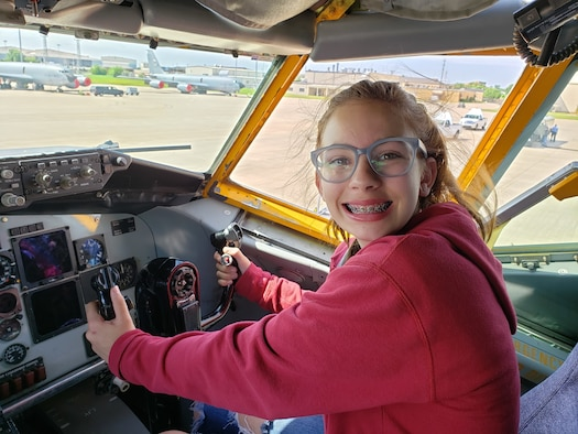 A student and participant in the 2019 Aviation Career Education Academy poses in the co-pilots chair of an Air Force Reserve KC-135R Stratotanker. The ACE academy provides middle school students weeklong immersion experiences in a variety of aviation and aerospace professions. The Oklahoma City ACE toured with the 507th ARW on June 5, 2019 at Tinker Air Force Base, Oklahoma. (U.S. Air Force Photo by Maj. Jon Quinlan)
