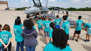 Pilots from the Oklahoma Air National Guard's 138th Fighter Wing brief students on the capabilities of the F-16 Fighting Falcon. The 2019 Aviation Career Education, or ACE academy provides middle and high school kids weeklong immersion experiences in a variety of aviation and aerospace professions. The Oklahoma City ACE toured with the 507th ARW on June 5, 2019 at Tinker Air Force Base, Oklahoma. The students received hands-on briefings and tours from pilots operating the KC-135R Stratotanker, F-16 Fighting Falcon and the T-6 Texan II aircraft. (U.S. Air Force Photo by Maj. Jon Quinlan)