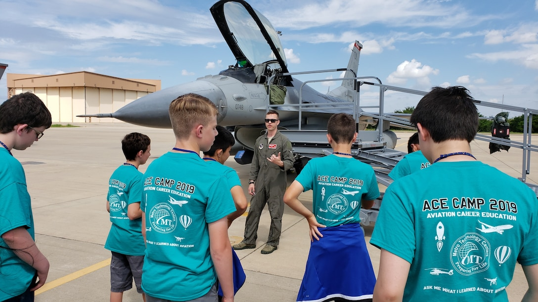 Pilots from the Oklahoma Air National Guard's 138th Fighter Wing brief students on the capabilities of the F-16 Fighting Falcon. The 2019 Aviation Career Education, or ACE academy provides middle and high school kids weeklong immersion experiences in a variety of aviation and aerospace professions. The Oklahoma City ACE toured with the 507th ARW on June 5, 2019 at Tinker Air Force Base, Oklahoma. (U.S. Air Force Photo by Maj. Jon Quinlan)