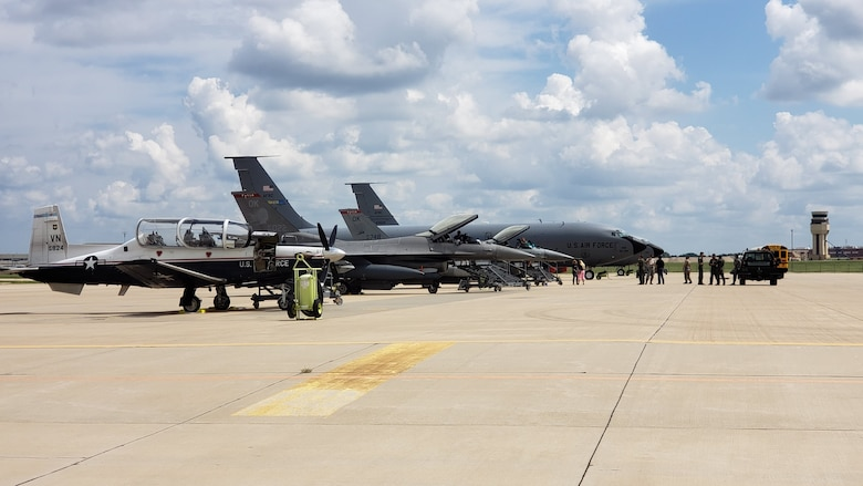 A KC-135R Stratotanker, two F-16 Fighting Falcons and a T-6 Texan II aircraft sit on the Reserve Ramp at the 507th Air Refueling Wing, June 5, 2019. (U.S. Air Force Photo by Maj. Jon Quinlan)