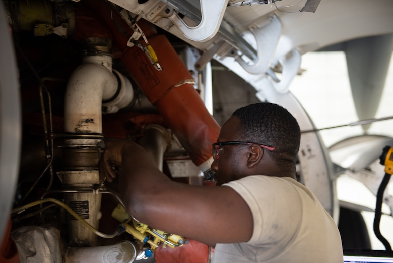 U.S. Air Force Airman 1st Class Leonard Howell, 62nd Maintenance Squadron electrical environmental apprentice, performs maintenance on the cooling system of a C-17 Globemaster III June 3, 2019, at Travis Air Force Base, California. Airmen from Joint Base Lewis-McChord, Washington, and Travis have completed 18 C-17 inspections since February. (U.S. Air Force photo by Tech. Sgt. James Hodgman)