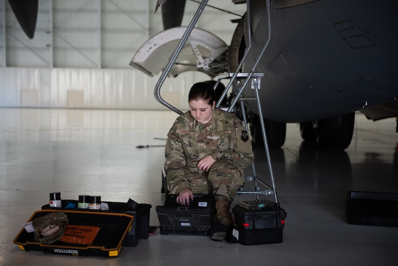 U.S. Air Force Senior Airman Kayla Laprade, 62nd Maintenance Squadron nondestructive inspection journeyman, reviews technical orders June 3, 2019, at Travis Air Force Base, California, prior to the inspection of the ram air inlet of a C-17 Globemaster III assigned to Joint Base Lewis-McChord, Washington. In February, JBLM sent its entire C-17 fleet to Travis to complete required maintenance and inspections. (U.S. Air Force photo by Tech. Sgt. James Hodgman)