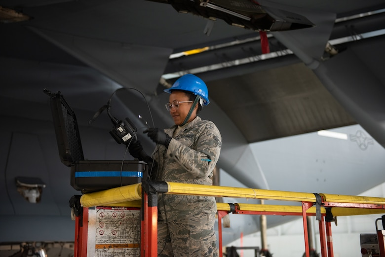 U.S. Air Force Senior Airman Tianda King, 860th Aircraft Maintenance Squadron inspection team member, puts away equipment after completing an inspection on a C-17 Globemaster III engine June 3, 2019, at Travis Air Force Base, California. Airmen from Joint Base Lewis-McChord, Washington, and Travis have completed 18 C-17 inspections since February. (U.S. Air Force photo by Tech. Sgt. James Hodgman)