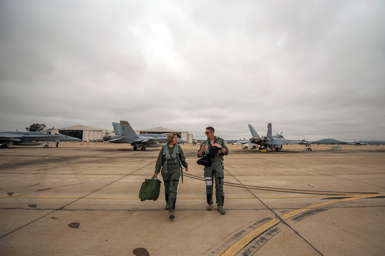 Staff Sgt. Saydee Osborn, 49th Equipment Maintenance Squadron Non-Destructive Inspection technician and Capt. Kenneth Durbin, 314th Fighter Squadron instructor pilot, step to and F-16 Viper June 4, 2019, on Marine Corps Air Station Miramar, Calif. During the duration of the temprary duty assignment, 258 training sortie missions were conducted. (U.S. Air Force photo by Staff Sgt. Christine Groening)