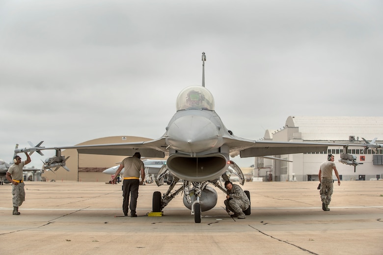Airmen from the 314th Aircraft Maintenance Unit ensure weapons are loaded to a 314th Fighter Squadron F-16 VIper, prior to take off June 4, 2019, on Marine Corps Air Station Miramar, Calif. The 314th FS F-16 pilots conducted dissimiliar combat air training alongside F/A-18 Hornets from the Marine Fighter Attack Squadron 314. (U.S. Air Force photo by Staff Sgt. Christine Groening)