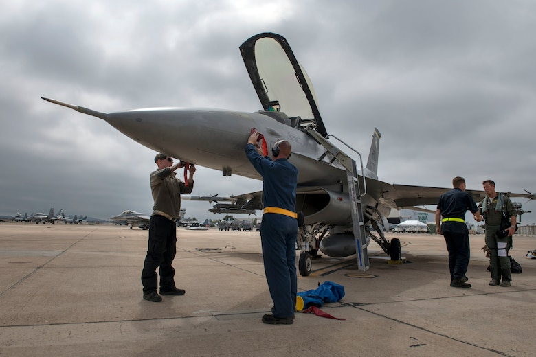 Airmen from the 314th Aircraft Maintenance Unit conduct post-flight maintenance on an F-16 Viper June 4, 2019, on Marine Corps Air Station Miramar, Calif. The 314th Fighter Squadron pilots conducted dissimiliar combat air training alongside F/A-18 Hornets from the Marine Fighter Attack Squadron 314. (U.S. Air Force photo by Staff Sgt. Christine Groening)