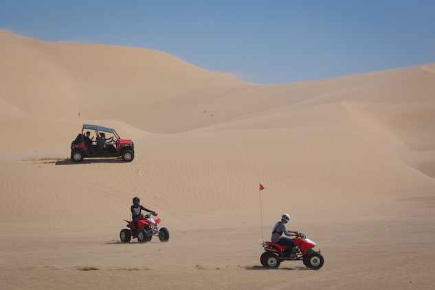 U.S. Marines with Marine Corps Air Station (MCAS) Yuma, ride 4x4 All-Terrain Vehicles and a Razor Side by Side through the Imperial Sand Dunes in El Centro Calif., April 29, 2019. MCCS Arizona Adventures is located aboard MCAS Yuma, affording Marines the opportunity to rent out an assortment of adrenaline-fueled gear including boats, jet skis, kayaks, and more. (U.S. Marine Corps photo by Sgt. Allison Lotz)
