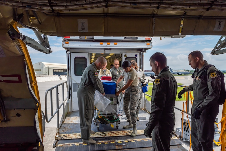 U.S. Air Force Airmen assigned to the 18th Aeromedical Evacuation Squadron and the 18th Aerospace Medicine Squadron load the neonatal transport system onto the KC-135 Stratotanker during a Neonatal Intensive Care Unit transportation course June 5, 2019, on Kadena Air Base, Japan. The NICU transportation course goes over the roles and responsibilities necessary when transporting an infant patient, what to expect, and what is essential to carry out the mission successfully. (U.S. Air Force photo by Airman 1st Class Cynthia Belío)