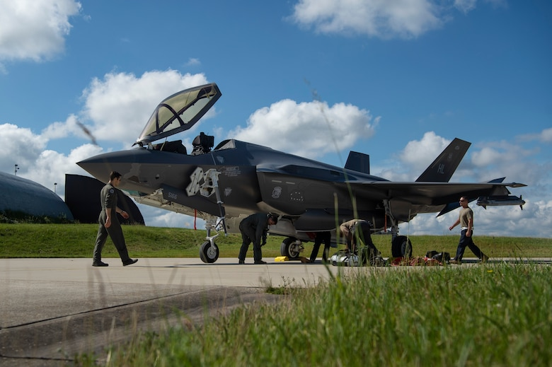U.S. Air Force Airmen de-arm an F-35A Lightning II fighter aircraft, assigned to the 421st Fighter Squadron, Hill Air Force Base, Utah, on the flight line at Spangdahlem Air Base, Germany, June 11, 2019. Multiple F-35s came to the European theater as part of a Theater Security Package to conduct training with partner nation aircraft. (U.S. Air Force photo by Airman 1st Class Valerie Seelye)
