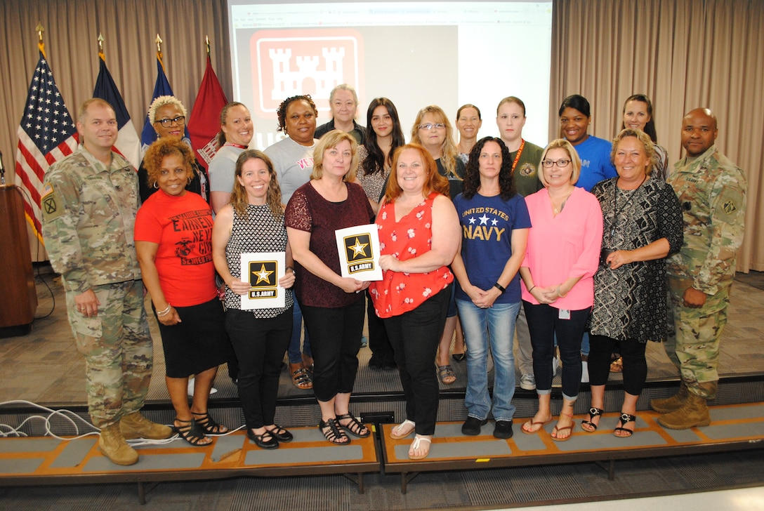 GALVESTON, Texas (June 11, 2019) – Commander Col. Lars Zetterstrom, U.S. Army Corps of Engineers Galveston District, and Maj. Christopher Beal, deputy district commander, join district employees to celebrate their service and contributions to the nation in recognition of Women Veterans Day. On June 12, 1948, President Harry S. Truman signed into law the Women's Armed Services Integration Act allowing women to serve as regular members of the military. Photo by Francisco G. Hamm.
