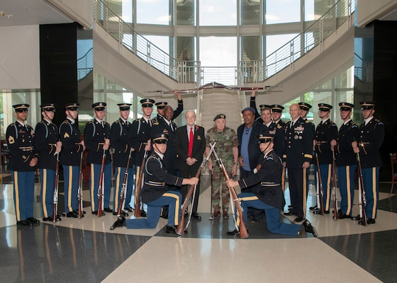 The U.S. Army Drill team poses for a photo with veterans Army Air Corps Master Sgt. Harry Miller (middle, left) and Army Sgt. 1st Class Rafael Lopez (middle, right) during a celebration of the Army's 244th birthday at the McNamara Headquarters Complex June 11.