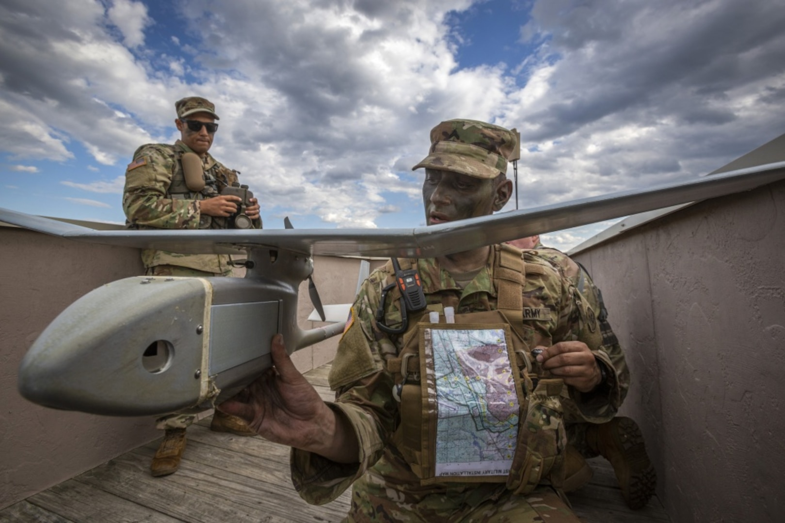 U.S. Army Cpl. Matthew G. Mena, Charlie Battery, 1st Battalion, 258th Field Artillery, New York Army National Guard, performs a systems check on an RQ-11 Raven B, a small unmanned aerial system