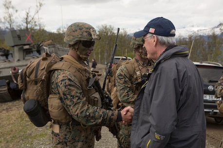 Secretary of the Navy Richard V. Spencer awards a challenge coin to a U.S. Marine with Marine Rotational Force-Europe 19.2, Marine Forces Europe and Africa, during exercise Thunder Reindeer 19 at Setermoen, Norway, June 5, 2019. Thunder Reindeer 19 is a multilateral, combined-arms, live-fire exercise that improves interoperability between the Norwegian Armed Forces and U.S. Marine Corps. (U.S. Marine Corps photo by Sgt. Williams Quinteros)