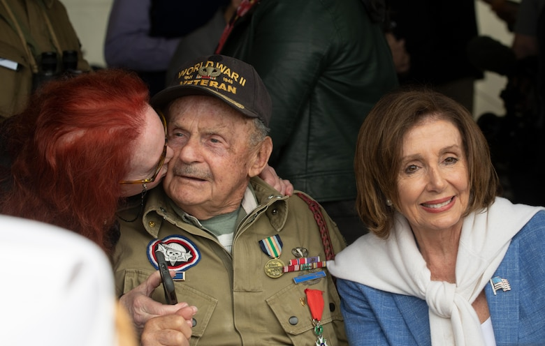World War II veteran Dan McBride (or George Merz) and U.S. House of Representatives president Nancy Pelosi pose for a photo at the D-Day 75 Commemorative Airborne Operation in Sainte-Mere-Eglise, France, June 9, 2019, which honors the epic airborne operation conducted by Allied forces on June 6, 1944. This commemorative airborne operation was an opportunity for multinational forces to honor the past and simultaneously work to secure the future. Training together in the very same place that trans-Atlantic resolve began 75 years ago demonstrates the partnerships and bonds that we highly value and continue to benefit from to this day. (U.S. Air Force photo by Airman 1st Class Jennifer Zima)