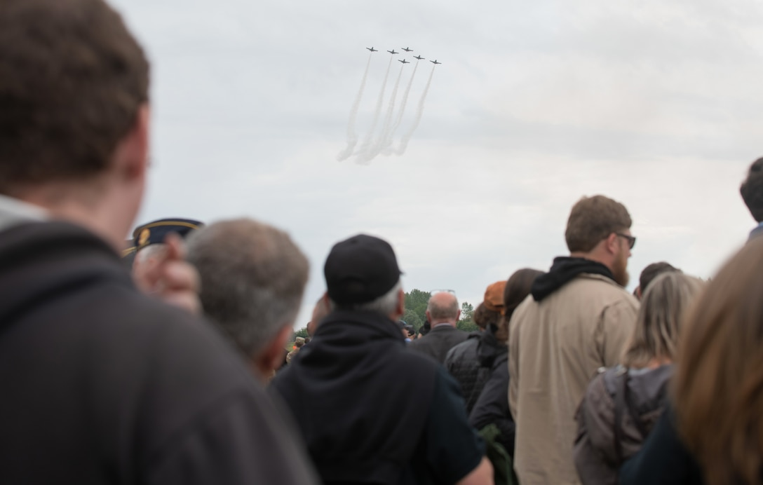 Spectators watch the aerial demonstrations at the D-Day 75 Commemorative Airborne Operation in Sainte-Mere-Eglise, France, June 9, 2019, which honors the epic airborne operation conducted by Allied forces on June 6, 1944. This commemorative airborne operation was an opportunity for multinational forces to honor the past and simultaneously work to secure the future. Training together in the very same place that trans-Atlantic resolve began 75 years ago demonstrates the partnerships and bonds that we highly value and continue to benefit from to this day. (U.S. Air Force photo by Airman 1st Class Jennifer Zima)