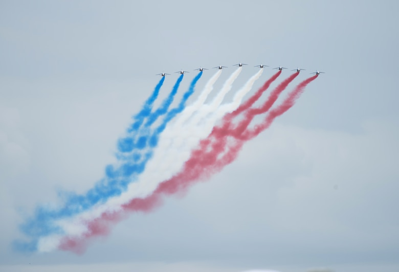The French national aerobatic team, Patrouille Acrobatique de France, performs aerial demonstrations at the D-Day 75 Commemorative Airborne Operation in Sainte-Mere-Eglise, France, June 9, 2019, which honors the epic airborne operation conducted by Allied forces on June 6, 1944. This commemorative airborne operation was an opportunity for multinational forces to honor the past and simultaneously work to secure the future. Training together in the very same place that trans-Atlantic resolve began 75 years ago demonstrates the partnerships and bonds that we highly value and continue to benefit from to this day. (U.S. Air Force photo by Airman 1st Class Jennifer Zima)