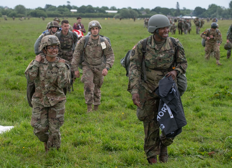 Service members leave the drop zone after a jump during the D-Day 75 Commemorative Airborne Operation in Sainte-Mere-Eglise, France, June 9, 2019, which honors the epic airborne operation conducted by Allied forces on June 6, 1944. Seventy-five years later, the bravery and heroism by all allies during World War II continues to resonate with U.S. forces in Europe - who remain steadfast in their commitment to European allies and partners. (U.S. Air Force photo by Airman 1st Class Jennifer Zima)
