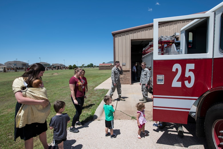 Cannon residents wait in line to see the inside of a fire engine at the new fire station at Cannon Air Force Base, N.M., June 6, 2019. The fire station, officially opened June 1, was constructed to provide a location for Cannon's firefighters closer to Chavez housing and respond to calls within their short time limit. (U.S. Air Force Photo by Airman 1st Class Vernon R. Walter III)