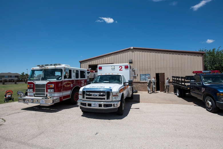 Air Commandos take a break after giving tours of the new fire station to members of base housing at Cannon Air Force Base, N.M., June 6, 2019. Firefighters have seven minutes to respond to a structural fire and the new station gives them the ability to arrive at any location in Chavez in less. (U.S. Air Force Photo by Airman 1st Class Vernon R. Walter III)