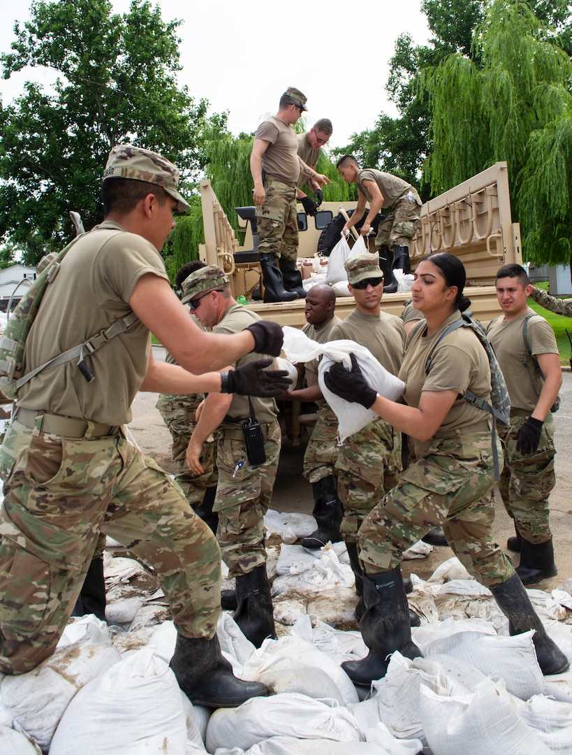 Illinois National Guard Soldiers load sandbags onto truck