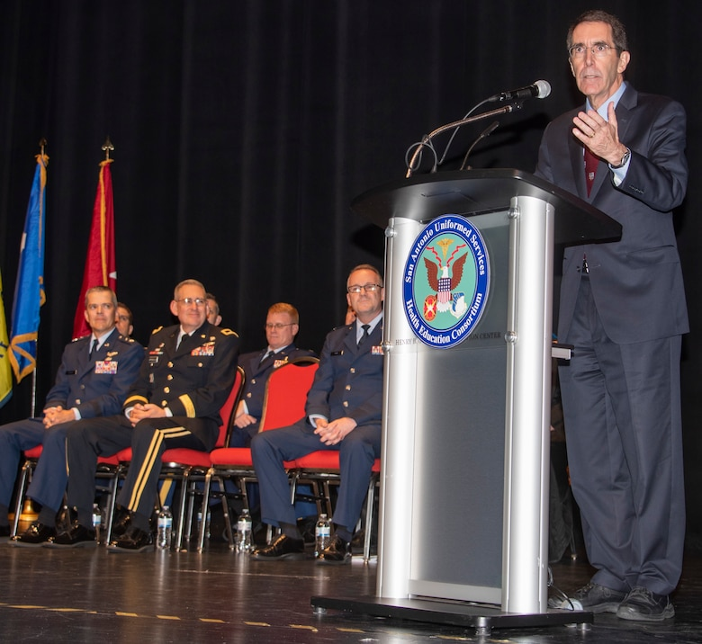 Dr. Arthur L. Kellermann, dean of the F. Edward Hebert School of Medicine, Uniformed Services University, speaks during the San Antonio Uniformed Services Health Education Consortium graduation ceremony at the Lila Cockrell Theatre in downtown San Antonio June 7. The ceremony honored 228 Army, Air Force, Navy, Public Health and civilian medical education and allied health graduates.