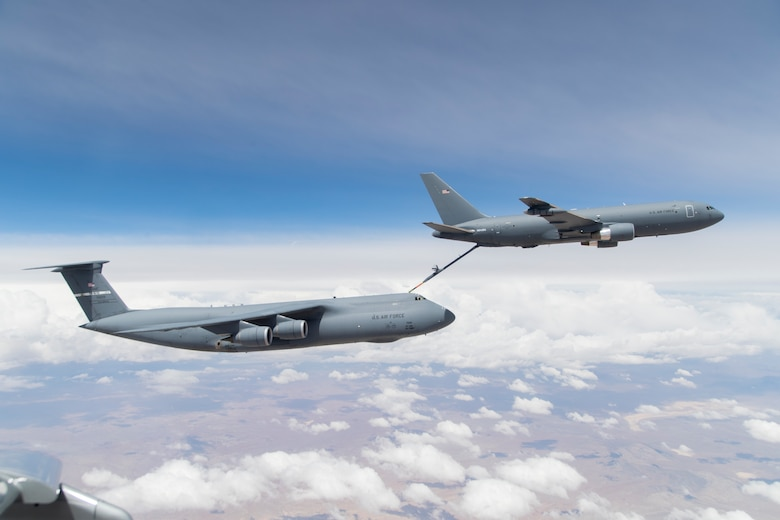 A KC-46A Pegasus out of Edwards Air Force Base, California, conducts testing with a C-5M Super Galaxy out of Travis Air Force Base, California, for the first time April 29, 2019. Travis will receive the KC-46, the Air Force's newest refueling aircraft, in 2023. (U.S. Air Force photo by Christian Turner)