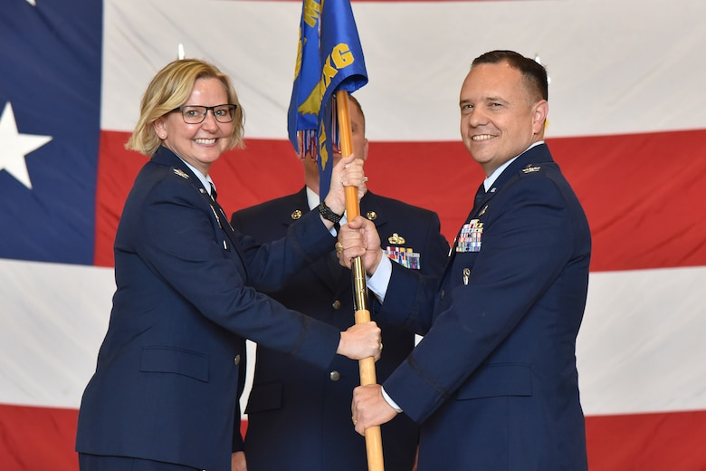 Col. Nathan Mitchell, right, accepts command of the 341st Maintenance Group from Col. Jennifer Reeves, 341st Missile Wing commander, during a change of command ceremony June 12, 2019, at Malmstrom Air Force Base, Mont.