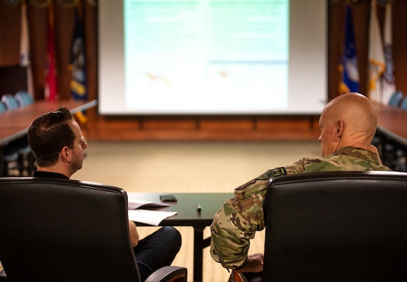 Maj. Gen. James O. Eifert, Florida's adjutant general, meets with Division of Emergency Management Director Jared Moskowitz, left, at Camp Blanding Joint Training Center's post headquarters to discuss the Florida National Guard's natural disaster response capabilities.