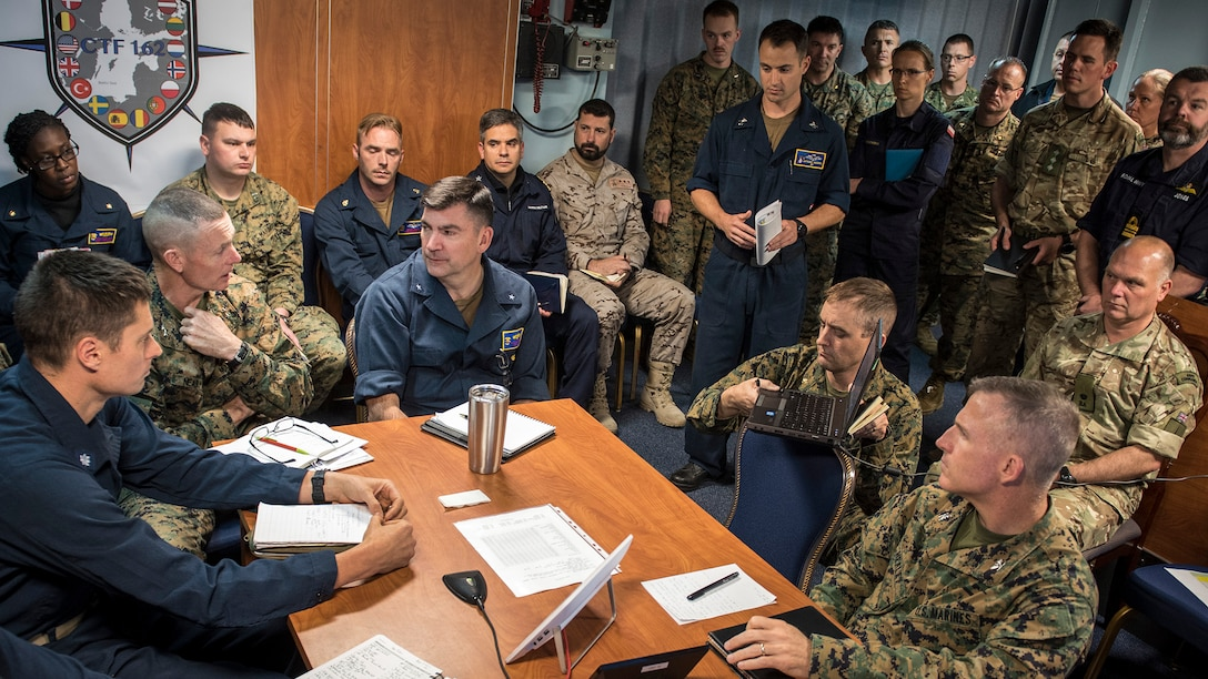 Maj. Gen. Stephen Neary, commanding general, 2nd Marine Expeditionary Brigade (left) and Rear Adm. Brad Skillman, commander, Expeditionary Strike Group 2 (right) conduct a commander's update brief aboard the Blue Ridge-class command and control ship USS Mount Whitney (LCC 20) during Exercise Baltic Operations 2019. BALTOPS is the premier annual maritime-focused exercise in the Baltic Region, marking the 47th year of one of the largest exercises in Northern Europe enhancing flexibility and interoperability among allied and partner nations. (U.S. Navy photo by Mass Communication Specialist 1st Class Theodore Green)