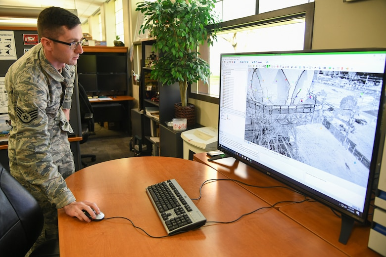 Staff Sgt. Austin Marshall, 84th Radar Evaluation Squadron, shows a scan from a 3-D terrestrial laser scanner April 17, 2019, at Hill Air Force Base, Utah. The survey section of the squadron recently received the new laser that provides faster and more accurate surveys around radar sites. (U.S. Air Force photo by Cynthia Griggs)