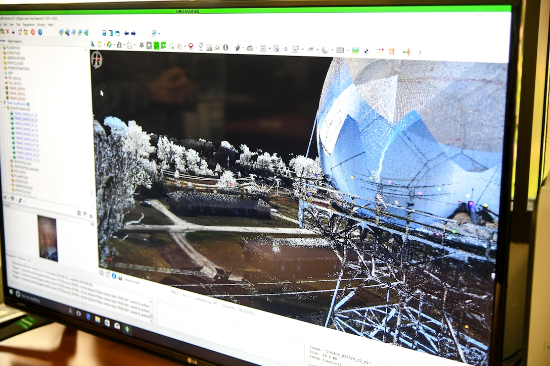 A scan with the overlaid digital photograph shows a 3-D model of a surveyed site. The survey section of 84th Radar Evaluation Squadron at Hill Air Force Base, Utah, recently received two 3-D terrestrial laser scanners for faster and more accurate surveys around radar sites. (U.S. Air Force photo by Cynthia Griggs)