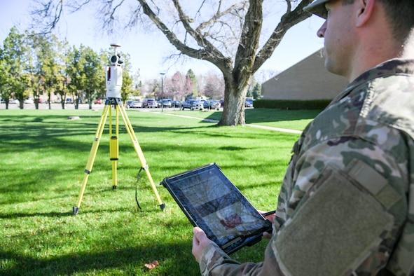 Staff Sgt. Ian Barone, 84th Radar Evaluation Squadron, demonstrates a 3-D terrestrial laser scanner April 17, 2019 at Hill Air Force Base, Utah. The survey section of the squadron recently received the new laser that provides faster and more accurate surveys around radar sites. (U.S. Air Force photo by Cynthia Griggs)