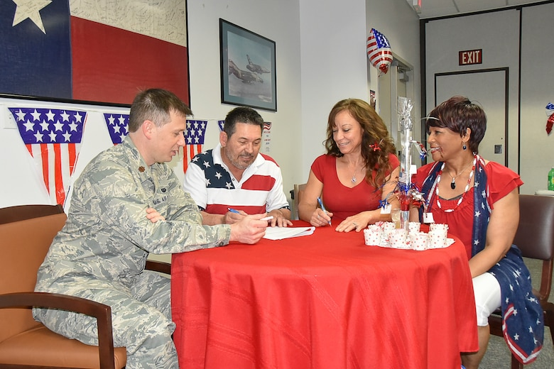 Maj. Ryan Springer, 301st Fighter Wing attorney and (right) Mrs. Evelyn Mickles, 301 FW paralegal and Law Day event coordinator, help a couple with various legal documents during the Law Day event held May 2, 2019 at Naval Air Station Fort Worth Joint Reserve Base, Texas. This event saved over 20 military retirees from the Fort Worth community $13,440 in document and service charges. (U.S. Air Force photo by Mr. Jeremy Roman)