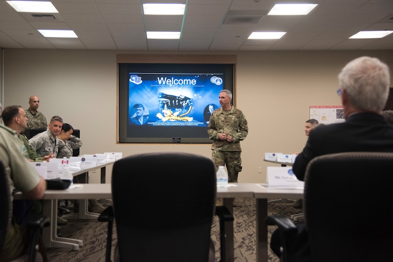 Maj. Gen. Stephen Whiting, 14th Air Force commander, briefs Sylvain Laporte, Canadian Space Agency president, during a tour June 12, 2019, at Vandenberg Air Force Base, Calif. During his visit, Laporte toured the CSpOC and learned how members of the CSpOC and 18th Space Control Squadron assist the U.S. Air Force Space Command mission. (U.S. Air Force photo by Airman 1st Class Aubree Milks)