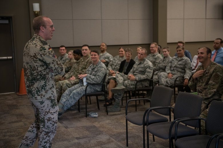 Capt. Eike Selle, German national in the German Reserve Luftwaffe (Air Force) visiting the 932nd Airlift Wing since June 1st, gives an overview of the German Reserves and some comparisons between Germany and United States to a group of Airmen from the 932nd AW,  June 12, 2019, Scott Air Force Base, Illinois. (U.S. Air Force photo by Christopher Parr)