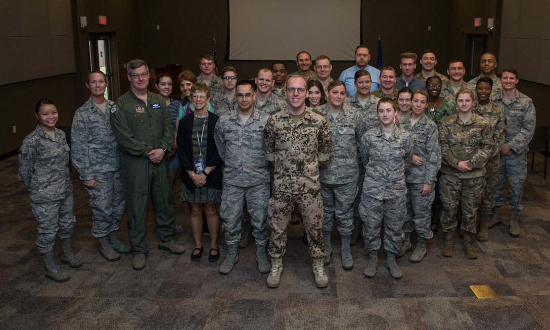 Capt. Eike Selle, officer in the German Reserve Luftwaffe (Air Force) visiting the 932nd Airlift Wing since June 1st, poses with the group of Airmen from the 932nd AW following his briefing about the German Reserve Air Force, June 12, 2019, Scott Air Force Base, Illinois. (U.S. Air Force photo by Christopher Parr)