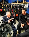 Army Parachute Team (Golden Knights) member Sgt 1st Class Ryan O'rourke (right) listens as Harry Read shares his memories of jumping into Normandy on D-Day 75 years ago.  The British WWII veteran later completed a tandem into Normandy with the British Red Devils parachute demonstration team.