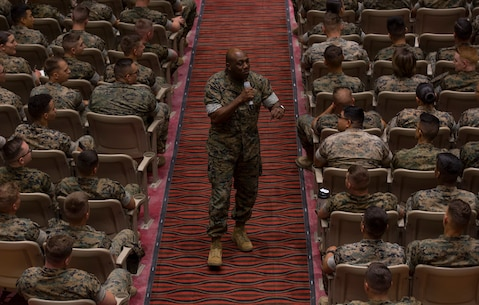 Sgt. Maj. of the Marine Corps Ronald L. Green addresses Marines at the Pendleton Theater and Training Center aboard Marine Corps Base Camp Pendleton, Calif., May 8, 2019.