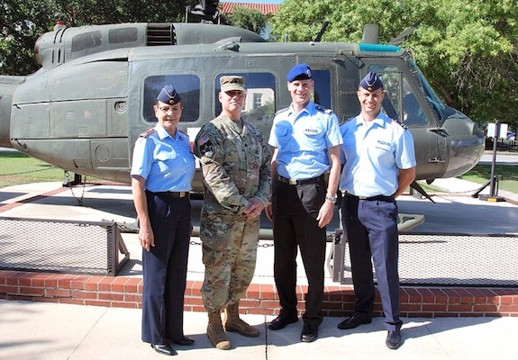 (From left) Maj. Gen. Gesine Kruger, commander for the German Bundeswehr Medical Academy, poses with Lt. Col. Larry Lindsey, Tactical Combat Medical Care Course director, Health Readiness Center of Excellence; Col. Kai Schlolaut, German Health Foreign Liaison Officer; and Lars Schmutzer, Adjutant, Academy Munich, during a visit to Joint Base San Antonio-Fort Sam Houston June 6.