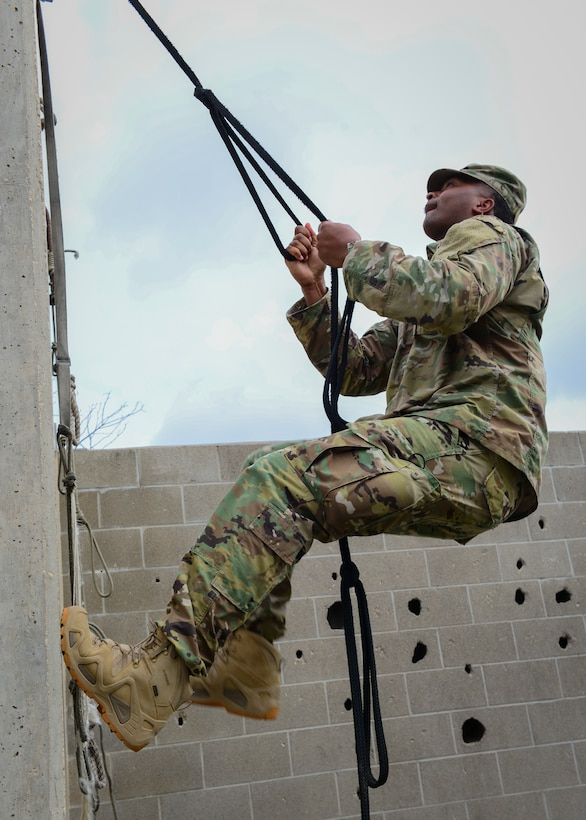An Air Force recruiter with the 330th Recruiting Squadron practices scaling a wall following instruction from Survival, Evasion, Resistance and Escape (SERE) cadre members from 66th Training Squadron, Det. 3,  at Joint Base San Antonio-Lackland June 3, 2019. Survival, Evasion, Resistance and Escape (SERE) cadre from are responsible for both the four-day Evasion and Conduct After Capture Course and the 15-day SERE Specialist Training Orientation Course at Joint Base San Antonio-Lackland. ECAC was the first stop for recruiters from the 330th RCS who travelled from across the United States to attend this biannual squadron training intended to immerse recruiters into SERE training  in order for them to be better able  to recruit Air Force SERE candidates.