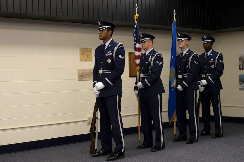 The 319th Air Base Wing Honor Guard stands in wait prior to a change of command ceremony June 11, 2019, on Cavalier Air Force Station, North Dakota. The change of command ceremony took place to say goodbye to outgoing commander, Lt. Col. Stephen Hobbs, and hello to incoming commander, Lt. Col. Ryan Durand, of the 10th Space Warning Squadron. (U.S Air Force photo by Senior Airman Elora J. Martinez)