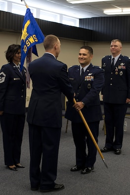 Lt. Col. Ryan Durand, incoming commander for the 10th Space Warning Squadron, accepts command during a ceremony June 11, 2019, on Cavalier Air Force Station, North Dakota. Durand assumed command from outgoing commander, Lt. Col. Stephen Hobbs. (U.S. Air Force photo by Senior Airman Elora J. Martinez)