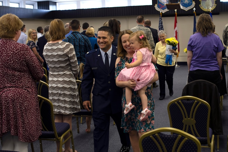 Lt. Col. Ryan Durand, 10th Space Warning Squadron commander, walks away from his change of command ceremony beside his wife and daughter June 11, 2019, on Cavalier Air Force Station, North Dakota. Durand assumed command of the northern-tier base from outgoing commander, Lt. Col. Stephen Hobbs. (U.S. Air Force photo by Senior Airman Elora J. Martinez)